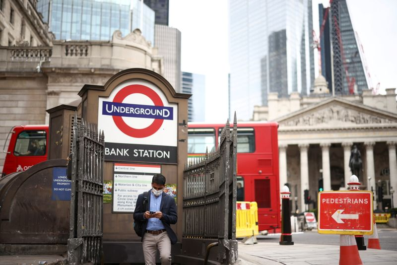 A person exits Bank underground station in the City of London financial district