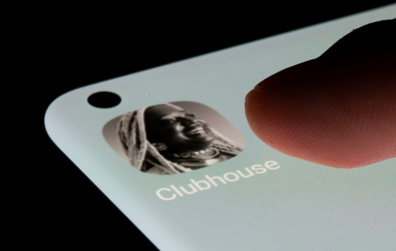 Clubhouse app is seen on a smartphone in this illustration