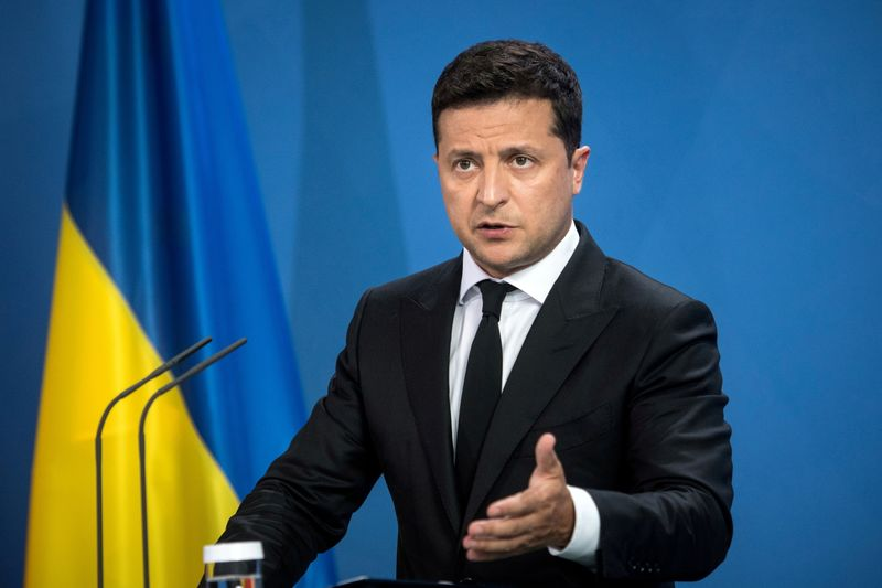 FILE PHOTO: Ukrainian President Volodymyr Zelenskiy gives statements ahead of talks at the Chancellery in Berlin