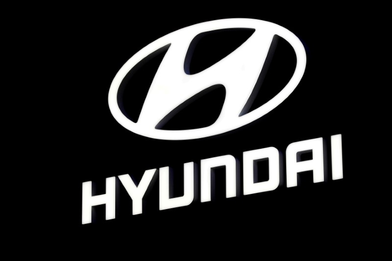 FILE PHOTO: FILE PHOTO: A Hyundai booth displays the company logo at the North American International Auto Show in Detroit