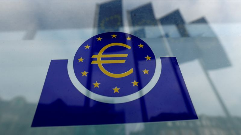 FILE PHOTO: FILE PHOTO: Specialists work on a crane in front of the European Central Bank (ECB) in Frankfurt, Germany
