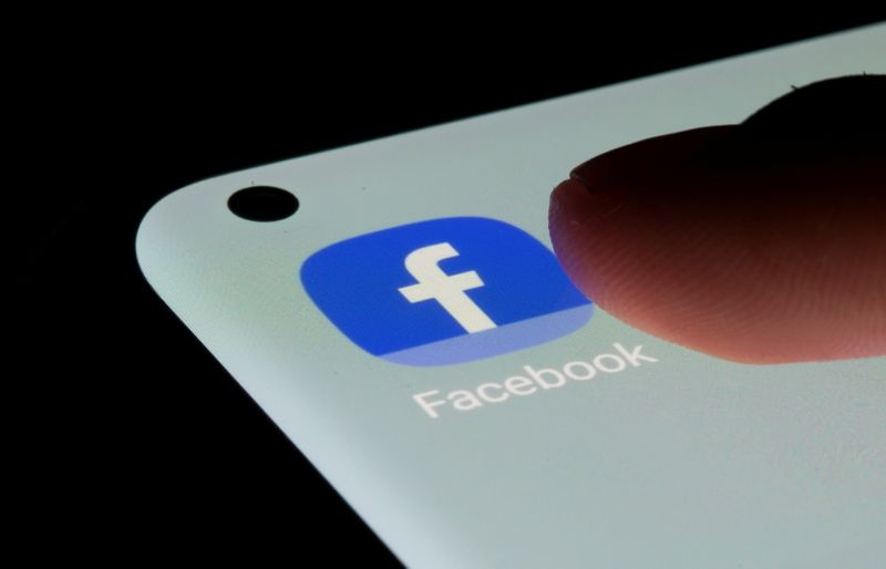 FILE PHOTO: Facebook app is seen on a smartphone in this illustration
