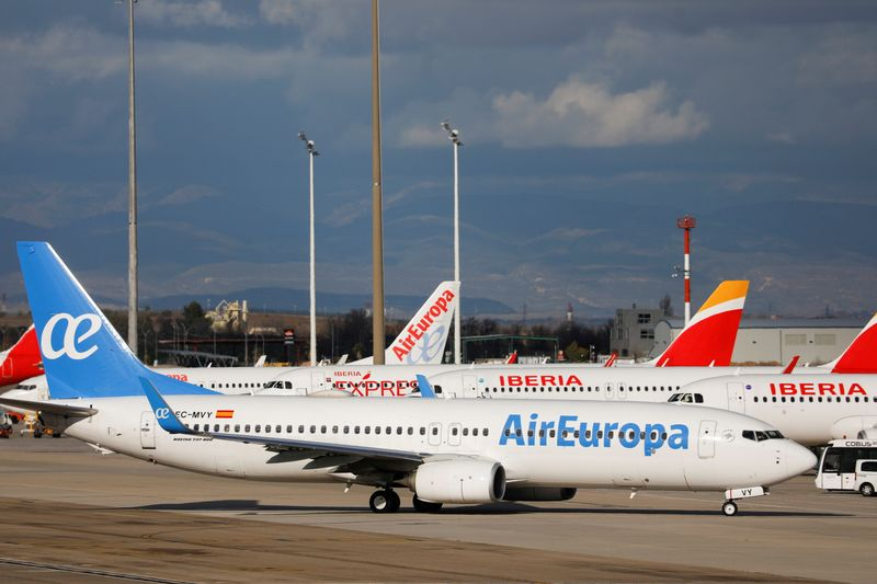 FILE PHOTO: Iberia and Air Europa airplanes are parked at a tarmack at Adolfo Suarez Barajas airport amid the coronavirus disease (COVID-19) pandemic in Madrid