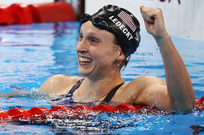 FILE PHOTO: Katie Ledecky (USA) reacts after winning and setting a new world record in Olympic women's 800m freestyle final