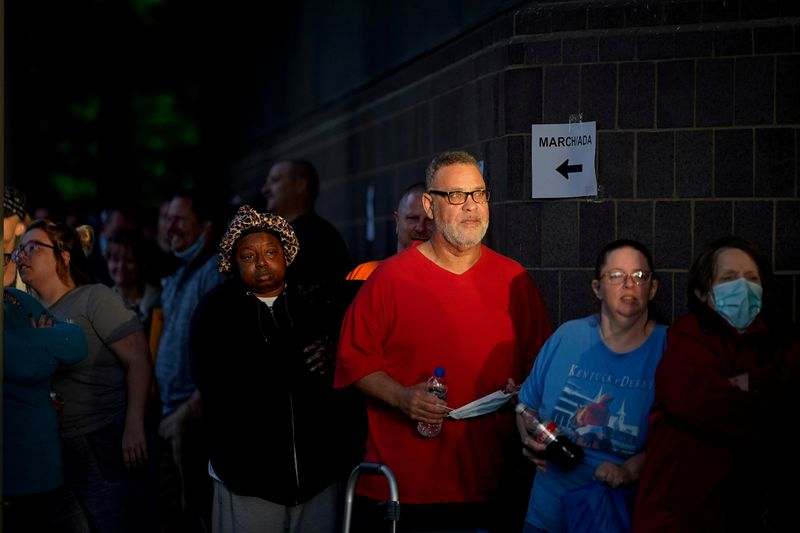 FILE PHOTO: People line up outside Kentucky Career Center in Frankfort