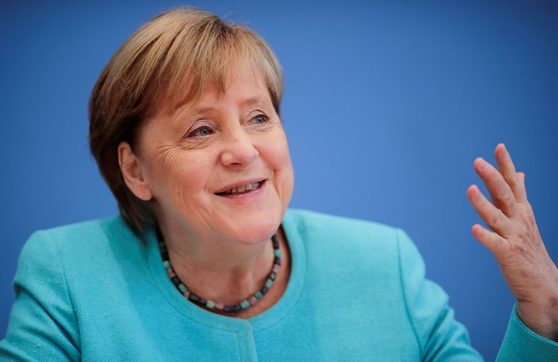 German Chancellor Merkel holds her annual summer news conference in Berlin
