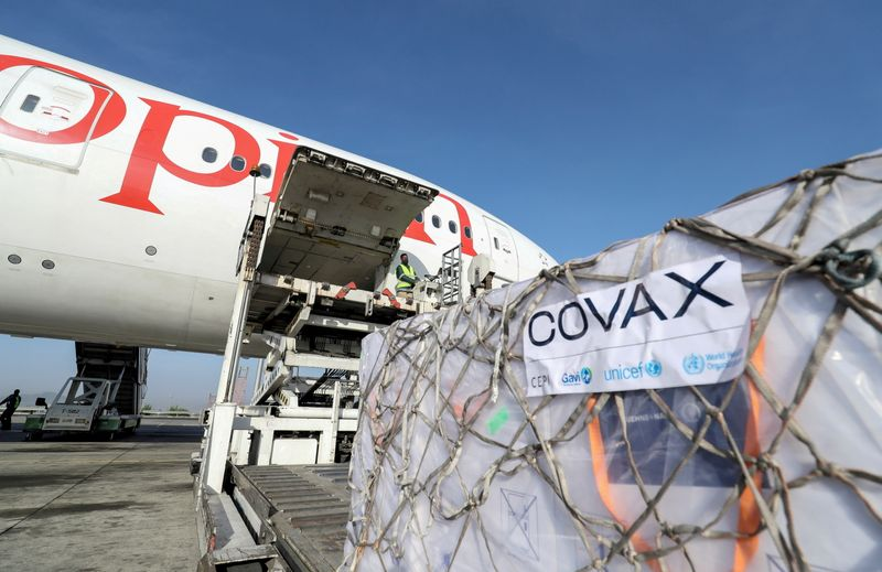 FILE PHOTO: AstraZeneca coronavirus vaccines from the COVAX vaccine-sharing scheme are unloaded from a cargo plane at Bole International Airport in Ethiopia