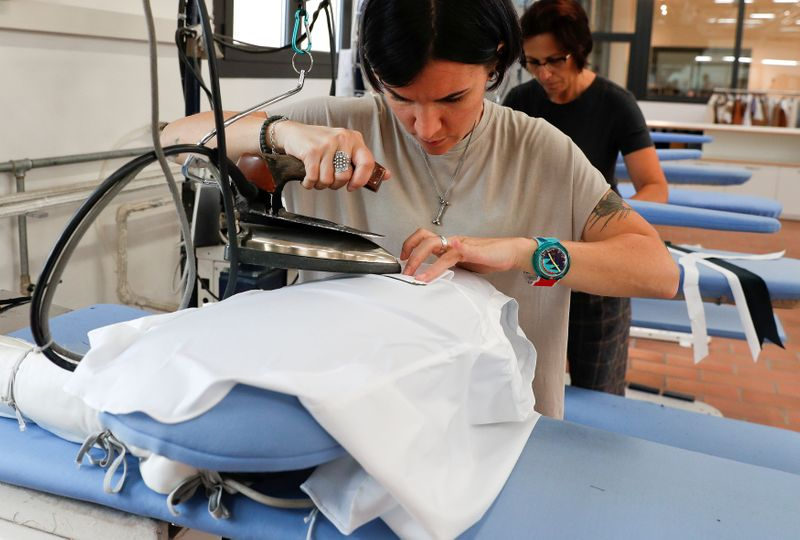 FILE PHOTO: A woman works at the Brunello Cucinelli factory in Solomeo village, near Perugia