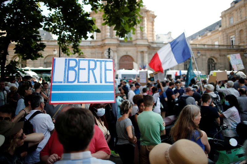 Demonstration against the new coronavirus safety measures including a compulsory health pass in front of the French Senate in Paris