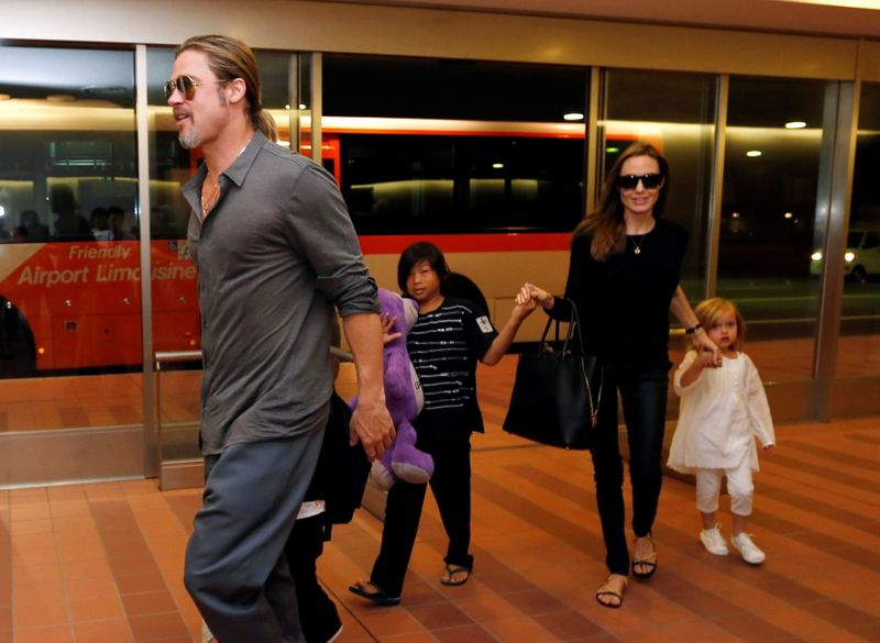 FILE PHOTO: Hollywood actors Brad Pitt and actress Angelina Jolie arrive with their children at Haneda international airport in Tokyo