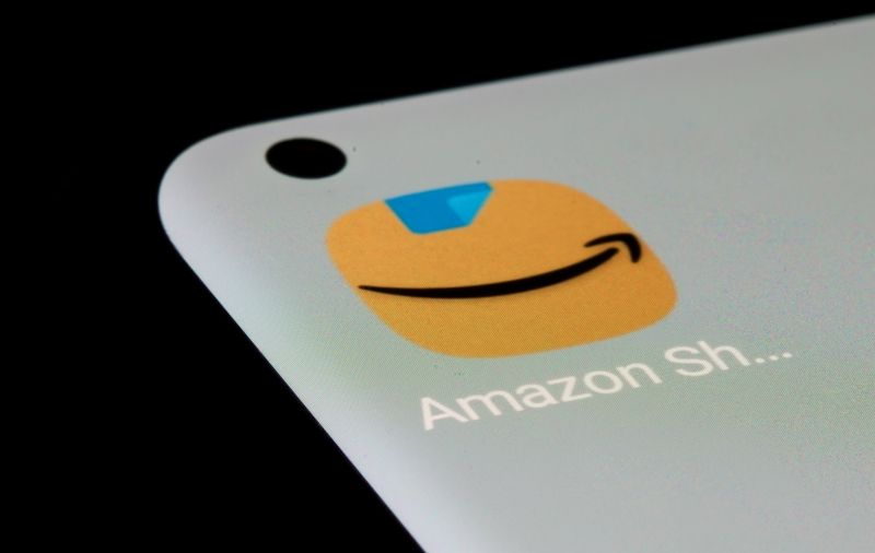Amazon app is seen on a smartphone in this illustration