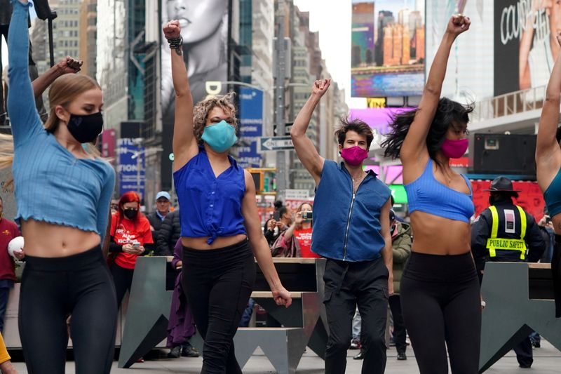 FILE PHOTO: Performers take part in a pop up Broadway performance in anticipation of Broadway reopening in New York City