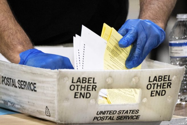 Fulton County Georgia elections workers process absentee ballots for the Senate runoff election in Atlanta on Jan. 5, 2021. (Ben Gray / AP Photo)