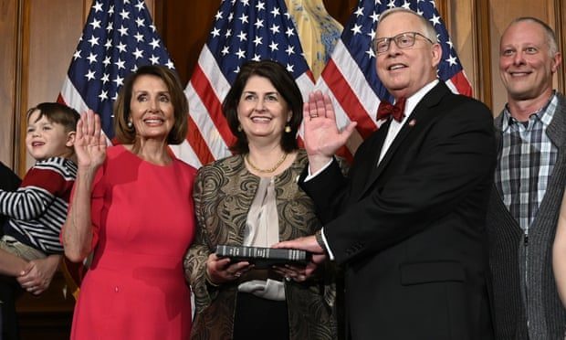 Susan Wright holds a Bible as her husband, Ron Wright, is sworn into Congress by the speaker, Nancy Pelosi. Ron Wright died in February. Photograph: Susan Walsh/AP