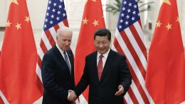 Chinese President Xi Jinping, right, shakes hands with then U.S. Vice President Joe Biden as they pose for photos at the Great Hall of the People in Beijing. (AP Photo/Lintao Zhang, Pool, File)