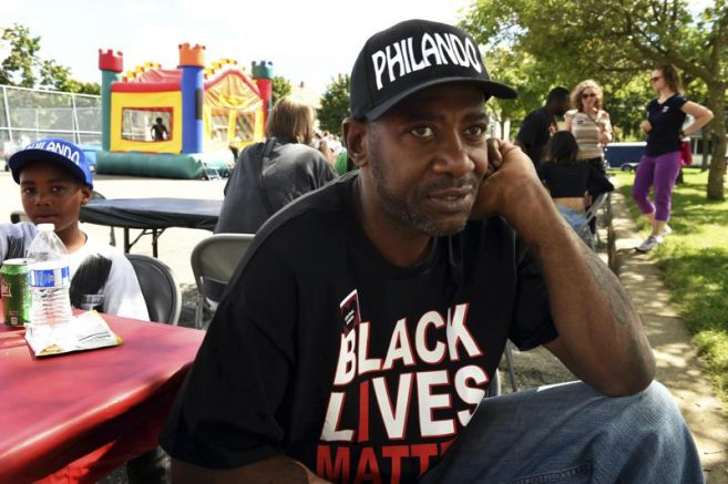 This Aug. 21, 2016 photo shows John Thompson, now a state representative, at a fundraiser at Central High School in St. Paul, Minn. (Scott Takushi/Pioneer Press via AP)