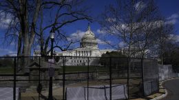 The U.S. Capitol is seen behind security fencing on Capitol Hill in Washington. (AP Photo/Carolyn Kaster)