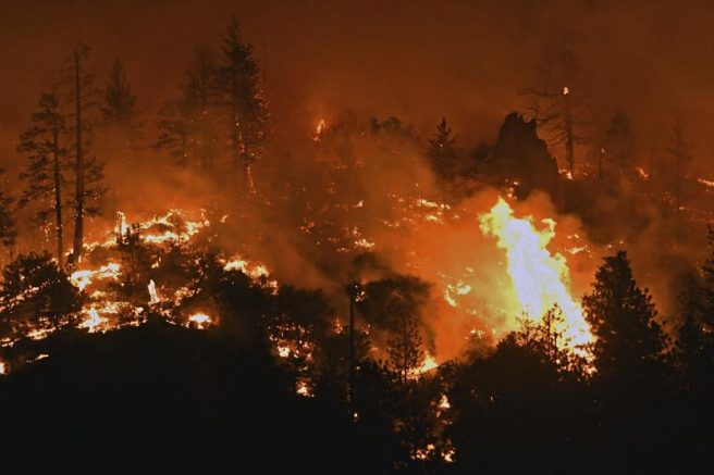 Flames from the Lava Fire burn along a ridge near U.S. Highway 97 and Big Springs Road north of Weed, Calif. (Scott Stoddard/Grants Pass Daily Courier via AP)