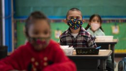 FILE — In this April 13, 2021, file photo, kindergarten students sit in their classroom on the first day of in-person learning at Maurice Sendak Elementary School in Los Angeles. (AP Photo/Jae C. Hong, File)