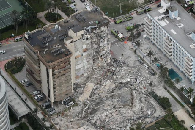This aerial photo shows part of the 12-story oceanfront Champlain Towers South Condo that collapsed in Surfside, Fla. (Amy Beth Bennett /South Florida Sun-Sentinel via AP)
