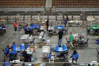 Maricopa County ballots cast in the 2020 general election are examined and recounted by contractors working for Florida-based company, Cyber Ninjas, Thursday, May 6, 2021 at Veterans Memorial Coliseum in Phoenix. (AP Photo/Matt York, Pool)