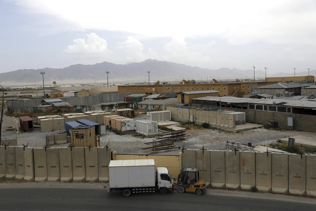 """Part of the sprawling Bagram air base is seen after the American military departed, in Parwan province north of Kabul, Afghanistan, Monday, July 5, 2021. The U.S. left Afghanistan's Bagram Airfield after nearly 20 years, winding up its """"forever war,"""" in the night, without notifying the new Afghan commander until more than two hours after they slipped away. (AP Photo/Rahmat Gul)"""