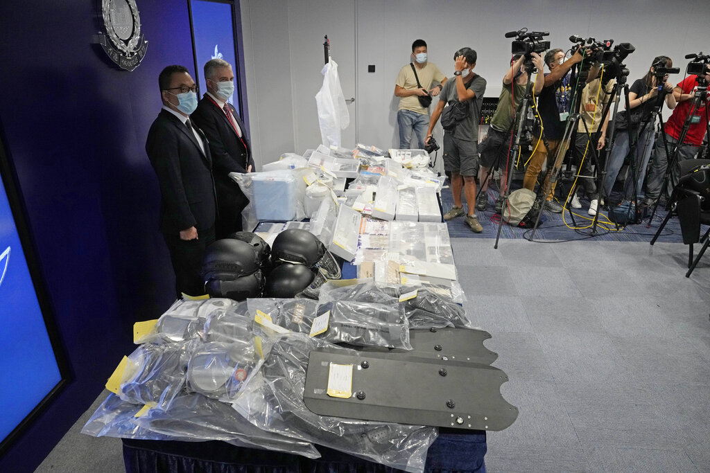 Confiscated evidence is displayed during a news conference as several people were arrested over the alleged plot to plant bombs around Hong Kong, at the police headquarters in Hong Kong, Tuesday, July 6, 2021. Hong Kong police on Tuesday said they arrested nine people on suspicion of engaging in terrorist activity, after uncovering an attempt to make explosives and plant bombs across the city.(AP Photo/Kin Cheung)