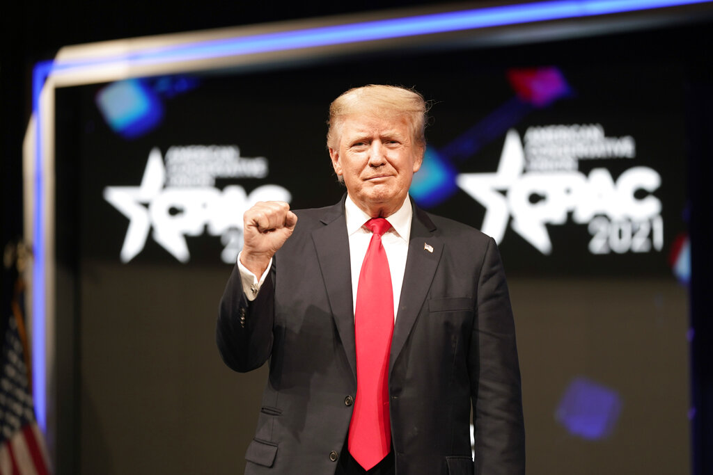 Former president Donald Trump raises his fist before speaking at the Conservative Political Action Conference (CPAC) Sunday, July 11, 2021, in Dallas. (AP Photo/LM Otero)