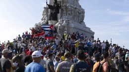 CORRECTS TO GOVERNMENT SUPPORTERS - Government supporters gather at the Maximo Gomez monument in Havana, Cuba, Sunday, July 11, 2021. Supporters of the government took to the streets at the time hundreds more protested against ongoing food shortages and high prices of foodstuffs.. (AP Photo/Eliana Aponte)