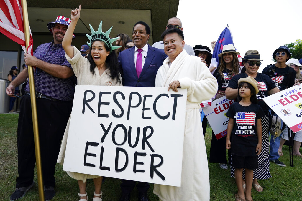 Radio talk show host Larry Elder poses for pictures with supporters during a campaign stop Tuesday, July 13, 2021, in Norwalk, Calif. Elder announced Monday that he is running for governor of California. (AP Photo/Marcio Jose Sanchez)