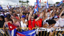 Demonstrators wave flags, Wednesday, July 14, 2021, in Miami's Little Havana neighborhood, as people rallied in support of antigovernment demonstrations in Cuba. (AP Photo/Wilfredo Lee)