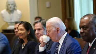 President Joe Biden takes a sip from a tea cup as the press leaves during a meeting with his Cabinet in the Cabinet Room at the White House in Washington, Tuesday, July 20, 2021. From left, Secretary of Health and Human Services Secretary Xavier Becerra, Secretary of the Interior Secretary Deb Haaland, Secretary of State Antony Blinken, Biden and Secretary of Defense Lloyd Austin. (AP Photo/Susan Walsh)