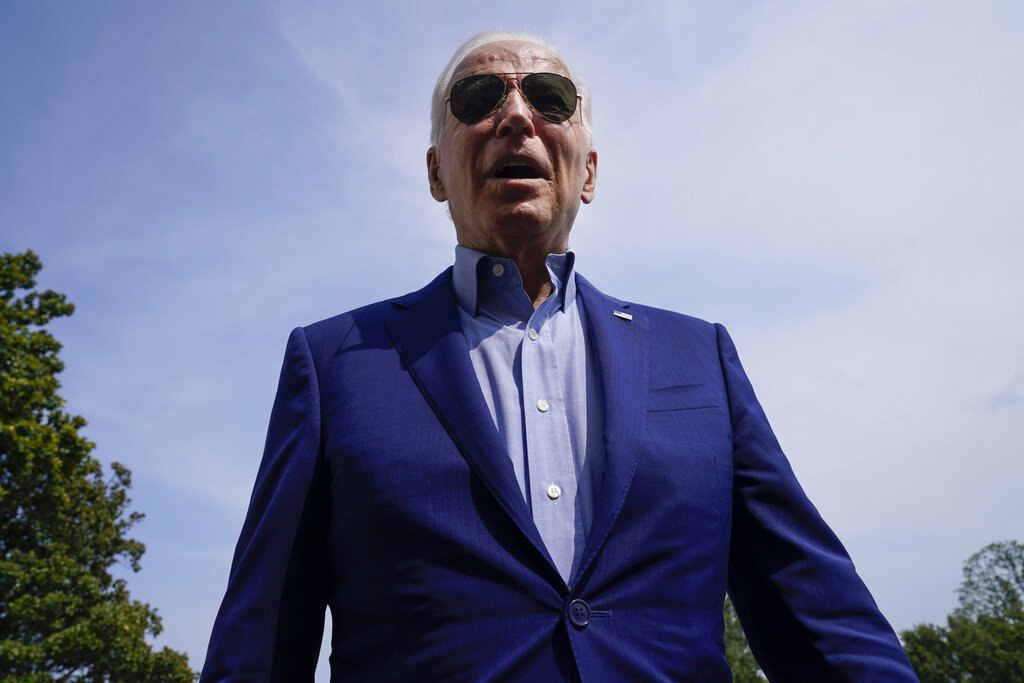 President Joe Biden, answering a question during his arrival the South Lawn of the White House after stepping off Marine One, Sunday, July 25, 2021, in Washington. Biden is returning to Washington after spending the weekend in Delaware. (AP Photo/Pablo Martinez Monsivais)