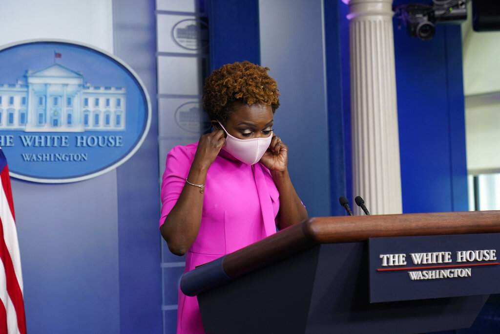White House deputy press secretary Karine Jean-Pierre takes off her mask as she arrives for the daily briefing at the White House in Washington, Thursday, July 29, 2021. (AP Photo/Susan Walsh)