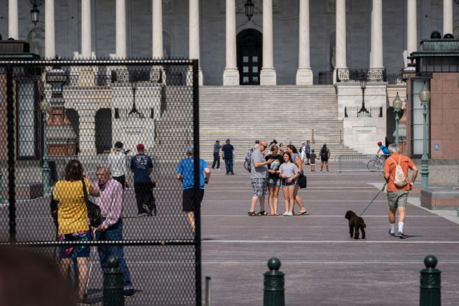 WASHINGTON, DC - JULY 10: Members of the public walk freely on the Capitol plaza as workers remove security fencing surrounding the U.S. Capitol on July 10, 2021 in Washington, DC. The security fence was erected in the wake of the January 6 attack on the Capitol and will be mostly removed this weekend. (Photo by Drew Angerer/Getty Images)