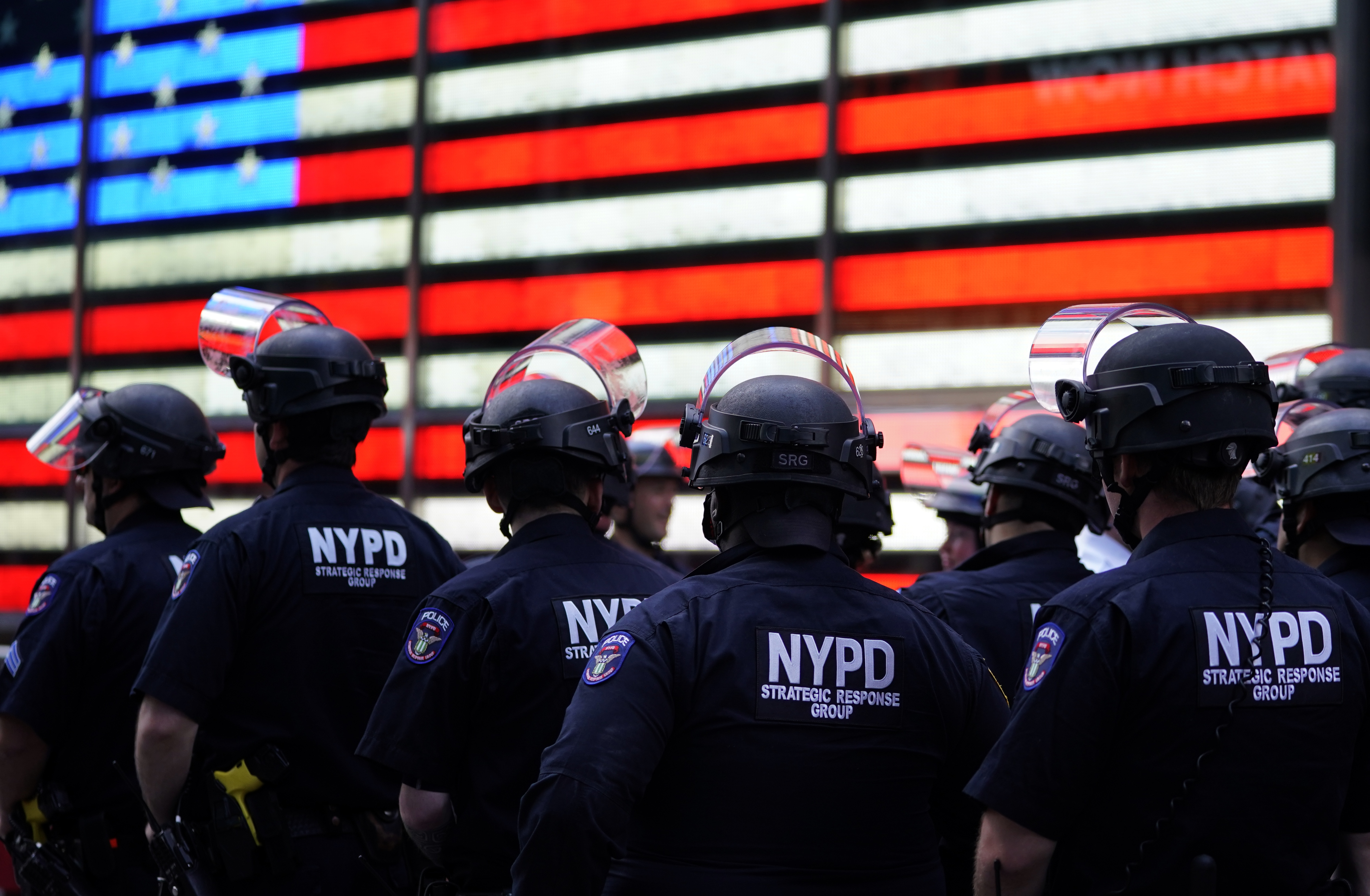 NYPD police officers in Times Square. (Photo by TIMOTHY A. CLARY/AFP via Getty Images)