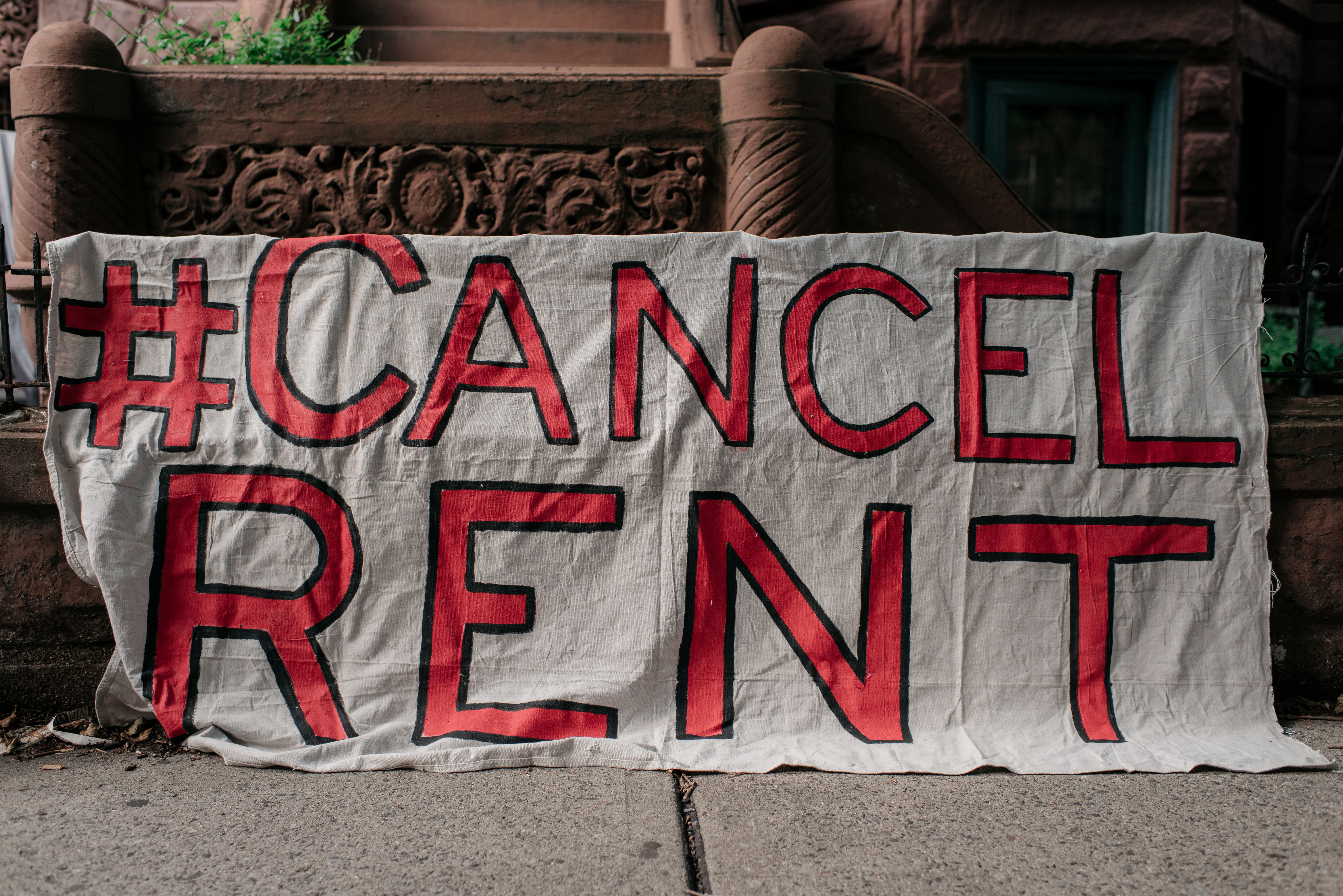 Housing activists gather to protest alleged tenant harassment by a landlord and call for cancellation of rent in the Crown Heights neighborhood on July 31, 2020 in Brooklyn, New York. (Photo by Scott Heins/Getty Images)