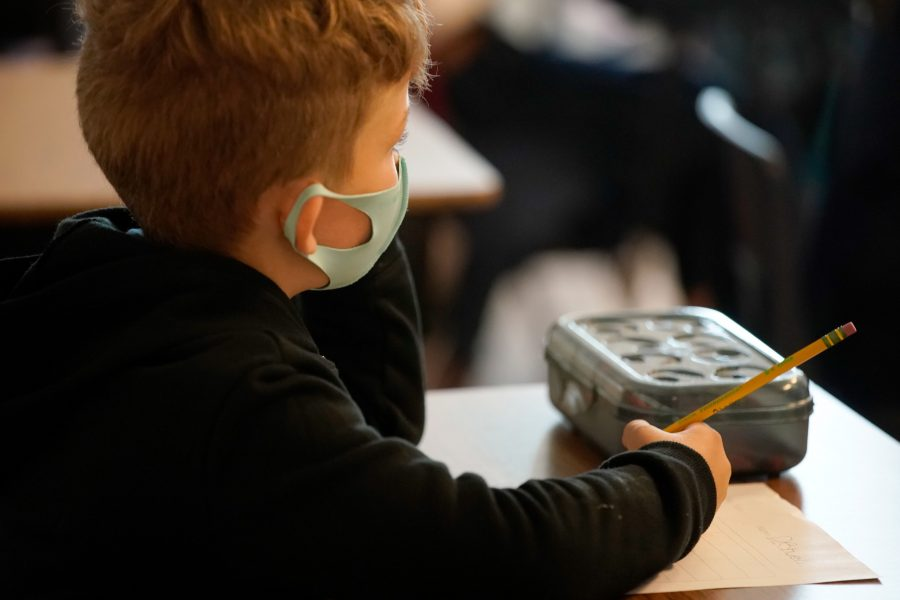 A student works on an assignment at Freedom Preparatory Academy on September 10, 2020 in Provo, Utah. - In person schooling with masks has started up in many Utah schools since shutting down in March of this year due to the covid-19 virus. (Photo by GEORGE FREY / AFP) (Photo by GEORGE FREY/AFP via Getty Images)