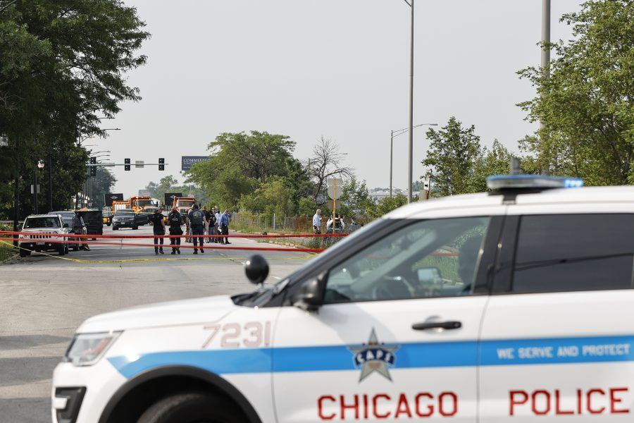 Law enforcement officers investigate a crime scene near the border between the Morgan Park and West Pullman neighborhoods on July 7, 2021 in Chicago, Illinois. Two ATF agents and one Chicago Police officer were shot as they worked undercover. (Photo by Kamil Krzaczynski/Getty Images)