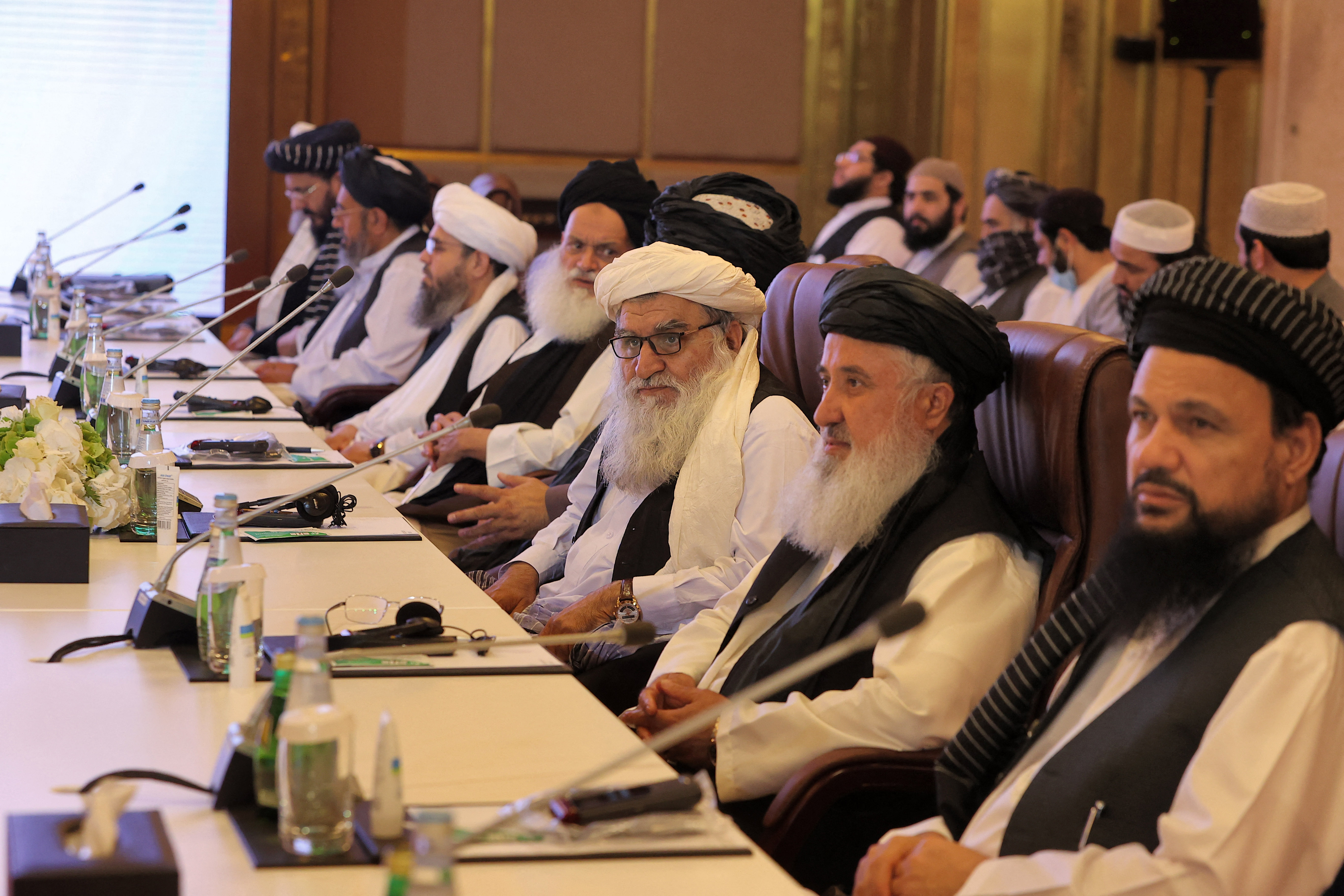 Members of the Taliban delegation look on during the presentation of the final declaration of the peace talks between the Afghan government and the Taliban in Qatar's capital Doha .(Photo by KARIM JAAFAR/AFP via Getty Images)