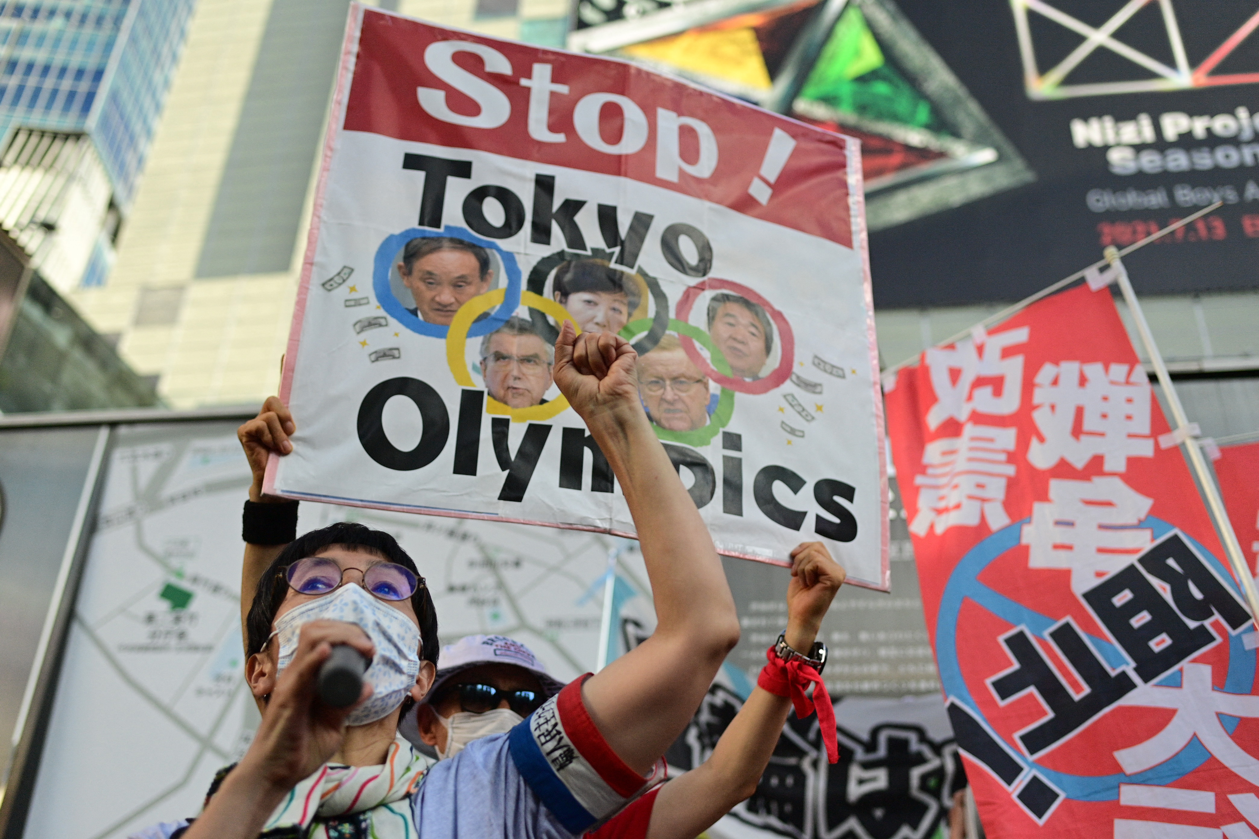People protest against the hosting of the Tokyo 2020 Olympic Games in Tokyo on July 23, 2021. (Photo by Philip FONG / AFP) (Photo by PHILIP FONG/AFP via Getty Images)