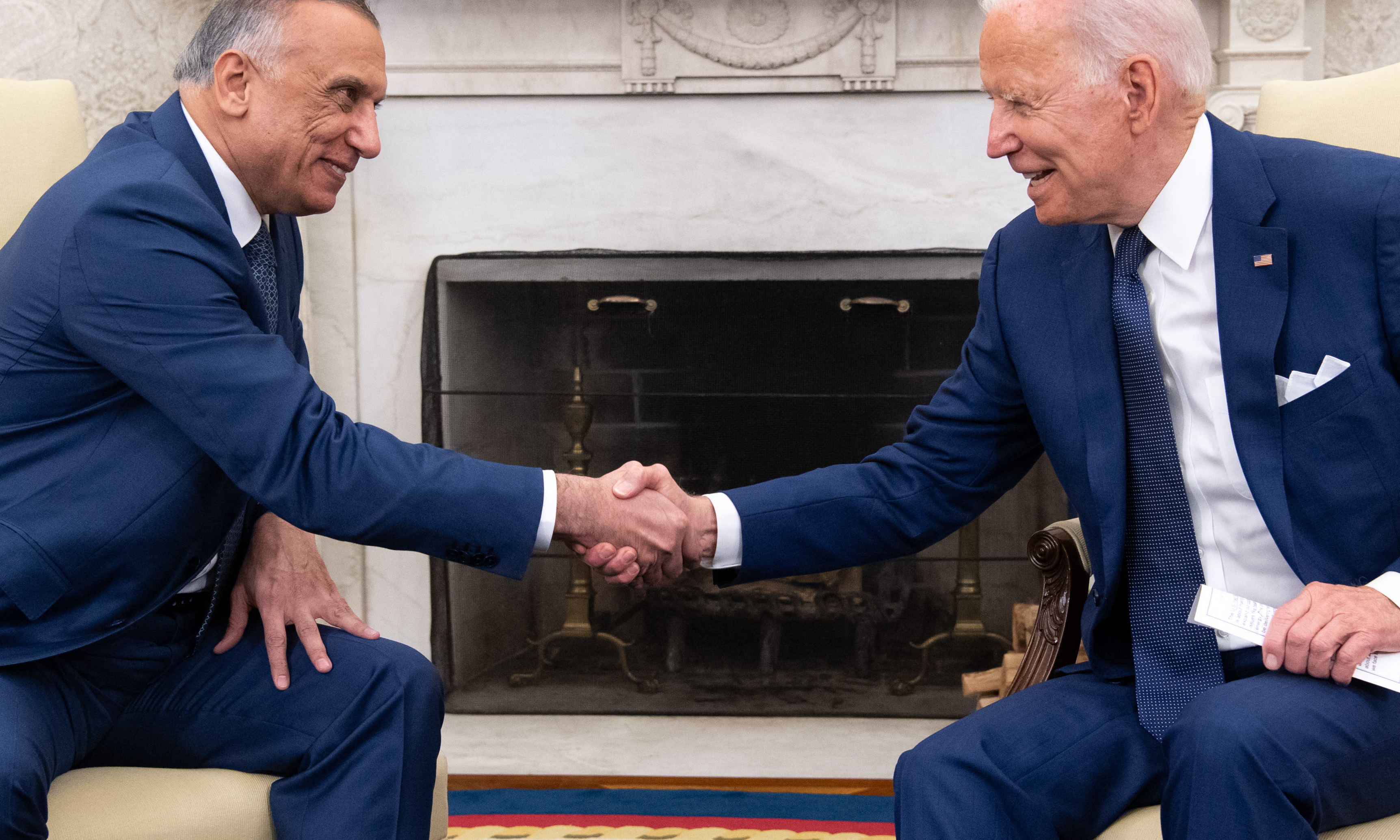 Joe Biden shakes hands with Iraqi Prime Minister Mustafa Al-Kadhimi, left, in the Oval Office of the White House in Washington, D.C., July 26, 2021. (Photo by SAUL LOEB/AFP via Getty Images)