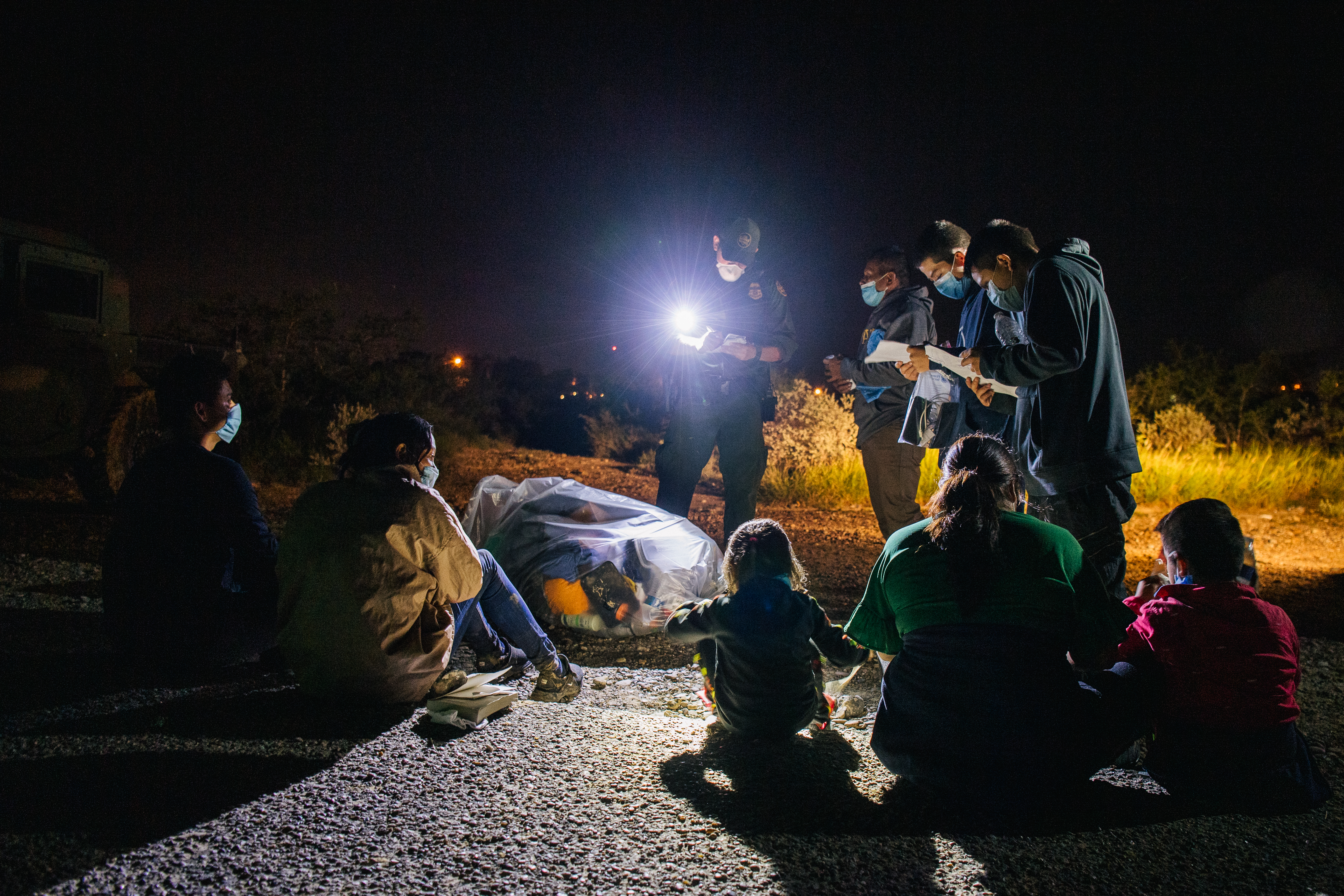 Migrants are accounted for and processed by border patrol after crossing the Rio Grande into the United States on July 01, 2021 in Roma, Texas. (Photo by Brandon Bell/Getty Images)