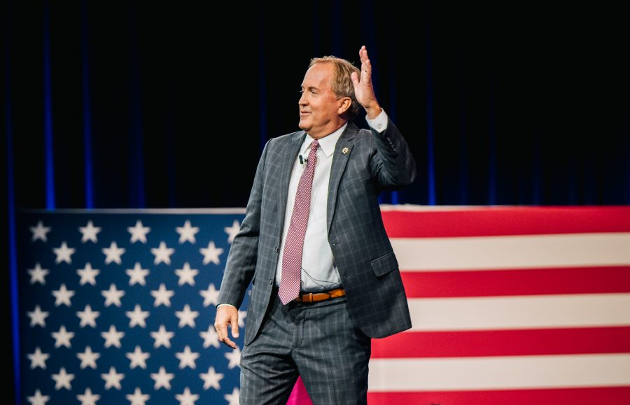 Texas Attorney General Ken Paxton waves after speaking during the Conservative Political Action Conference CPAC held at the Hilton Anatole in Dallas, Texas. (Photo by Brandon Bell/Getty Images)