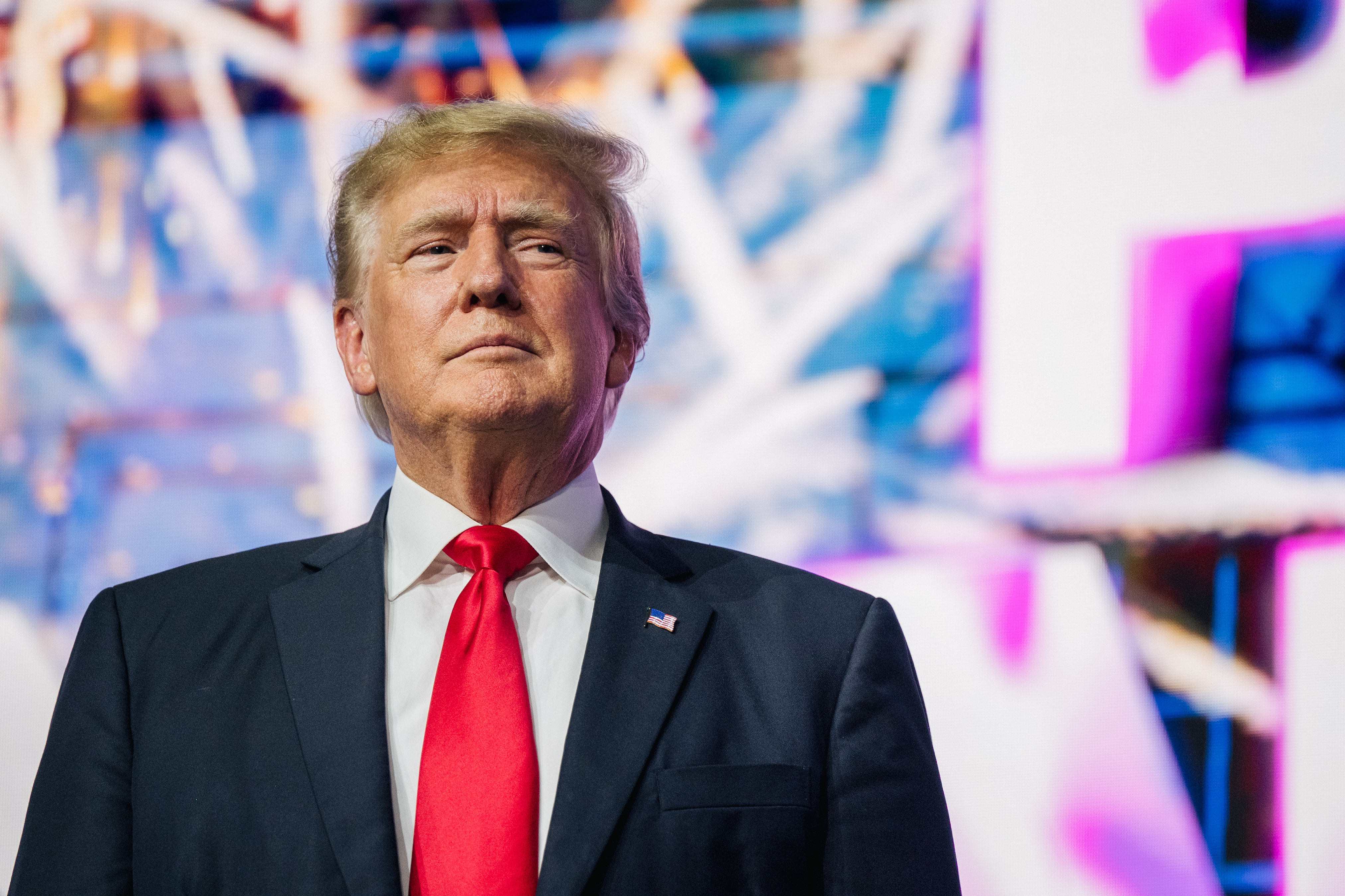 President Donald Trump makes an entrance at the Rally To Protect Our Elections conference on July 24, 2021 in Phoenix, Arizona. (Photo by Brandon Bell/Getty Images)