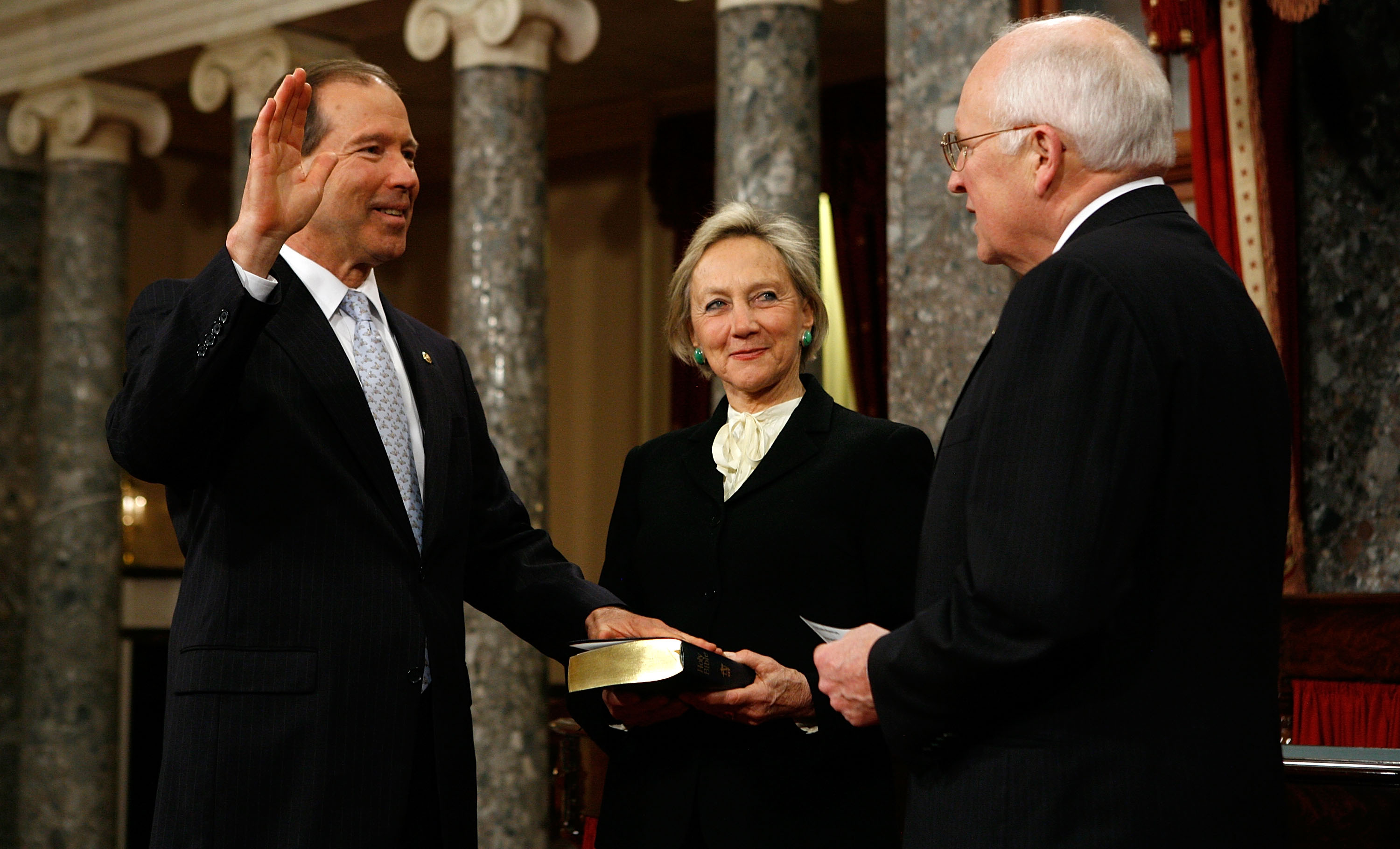 U.S. Sen. Tom Udall (D-N.M.), left, poses for photographers with his wife Jill (C) and former Vice President Dick Cheney, right, during a mock swearing-in ceremony on Capitol Hill January 6, 2009 in Washington, DC. (Photo by Alex Wong/Getty Images)