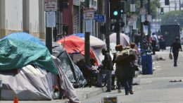 FILE - In this May 30, 2019 file photo, tents housing homeless line a street in downtown Los Angeles. California Gov. Gavin Newsom on Thursday, Sept. 26, 2019, signed legislation aimed at boosting construction of supportive housing and shelters in Los Angeles, Orange County and San Jose. (AP Photo/Richard Vogel, File)