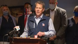 MARIETTA, GA - APRIL 10: Georgia Gov. Brian Kemp speaks at a news conference about the state's new Election Integrity Law that passed this week at AJ's Famous Seafood and Poboys on April 10, 2021 in Marietta, Georgia. Major League Baseball announced it would move the All-Star Game out of Georgia in response to the election bill, which opponents claim will negatively affect the minority population's ability to vote. There is also a concern for the economic impact this will have on the state following the MLB's decision. The bill's passage follows the Governor's decision to lift many of the restrictions in place for protection from COVID-19. (Photo by Megan Varner/Getty Images