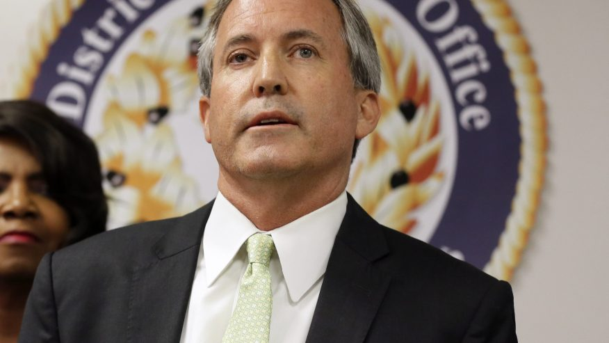 Texas Attorney General Ken Paxton makes comments during a news conference in Dallas (AP Photo/Tony Gutierrez)
