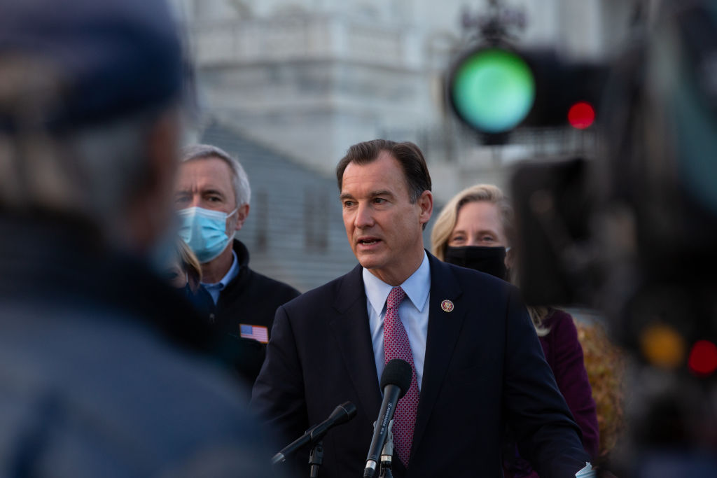 WASHINGTON, DC - DECEMBER 21: Rep. Tom Suozzi (D-NY) speaks at the podium standing with members of the Problem Solvers Caucus to praise the forthcoming passage of the bipartisan emergency COVID-19 relief bill in a press conference outside the US Capitol on December 21, 2020 in Washington, DC. The bipartisan group took credit for leading the negotiations that led to a deal that will include direct payments, extended unemployment benefits and small business loans. (Photo by Cheriss May/Getty Images)